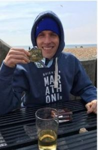 Stu Nicholas rehydrating after Brighton Marathon