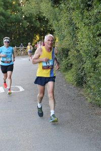 Ian Graham finishing the Purbeck 10k