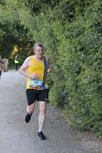 Mike White finishing the Purbeck 10k