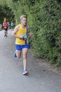 Phil Cherrett finishing the Purbeck 10k