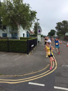 Tamzin Petersen turns the corner in the Poole Festival of Running 10k