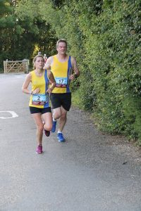 Tamzin Petersen and Richard Cannings finishing the Purbeck 10k