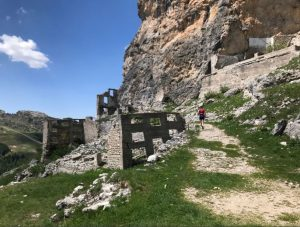 Heading past some ruins in the Cortina Trail
