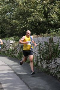 Alex Goulding finishing the Round the Rock 10k