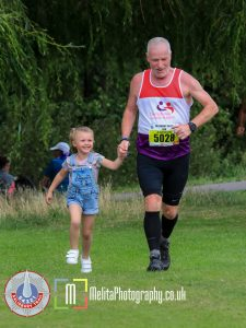 Andy Gillespie and his granddaughter finishing the Salisbury 54321 50k