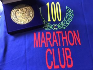 Andy Gillespie's 100 Club Marathon medal and t-shirt