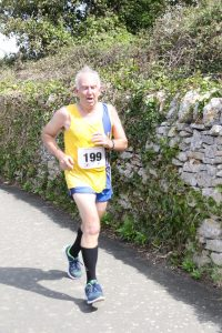 Dave Parsons finishing the Round the Rock 10k