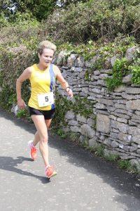 Helen Ambrosen finishing the Round the Rock 10k