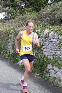 Jud Kirk finishing the Round the Rock 10k
