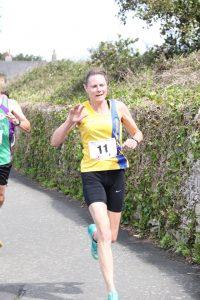 Julia Austin finishing the Round the Rock 10k