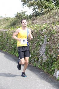 Matt du Cros finishing the Round the Rock 10k