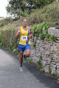Richard Brawn finishing the Round the Rock 10k