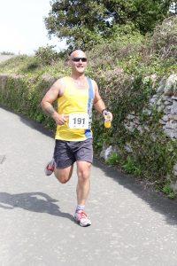 Wayne Walford Jelks finishing the Round the Rock 10k