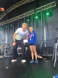 Isabel Cherrett collects her prize at the New Forest Marathon 5k