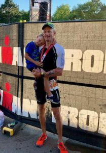 Paul Consani with his son after Ironman Vichy