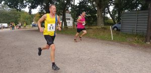 Simon Hearn pushes on in the Lytchett Relays