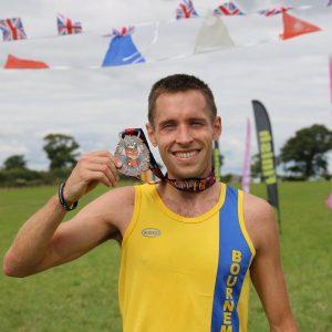 Stu Nicholas with medal after Crafty Fox Marathon