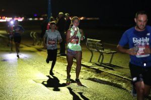 Girl lit up at Bournemouth Marathon Festival Supernova 5k