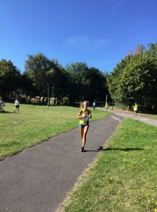 Harriet Slade approaches the finish in the Littledown 5