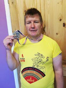 Julian Oxborough with medal after the Salisbury Half Marathon