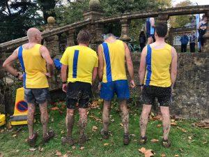 Men all muddy after Wessex League XC race at Lytchett School