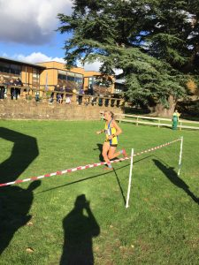 Lisa Elmore finishing the Wessex League XC at Lytchett School