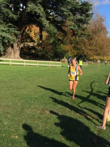Lisa Elmore finishing the Wessex League XC race at Lytchett School