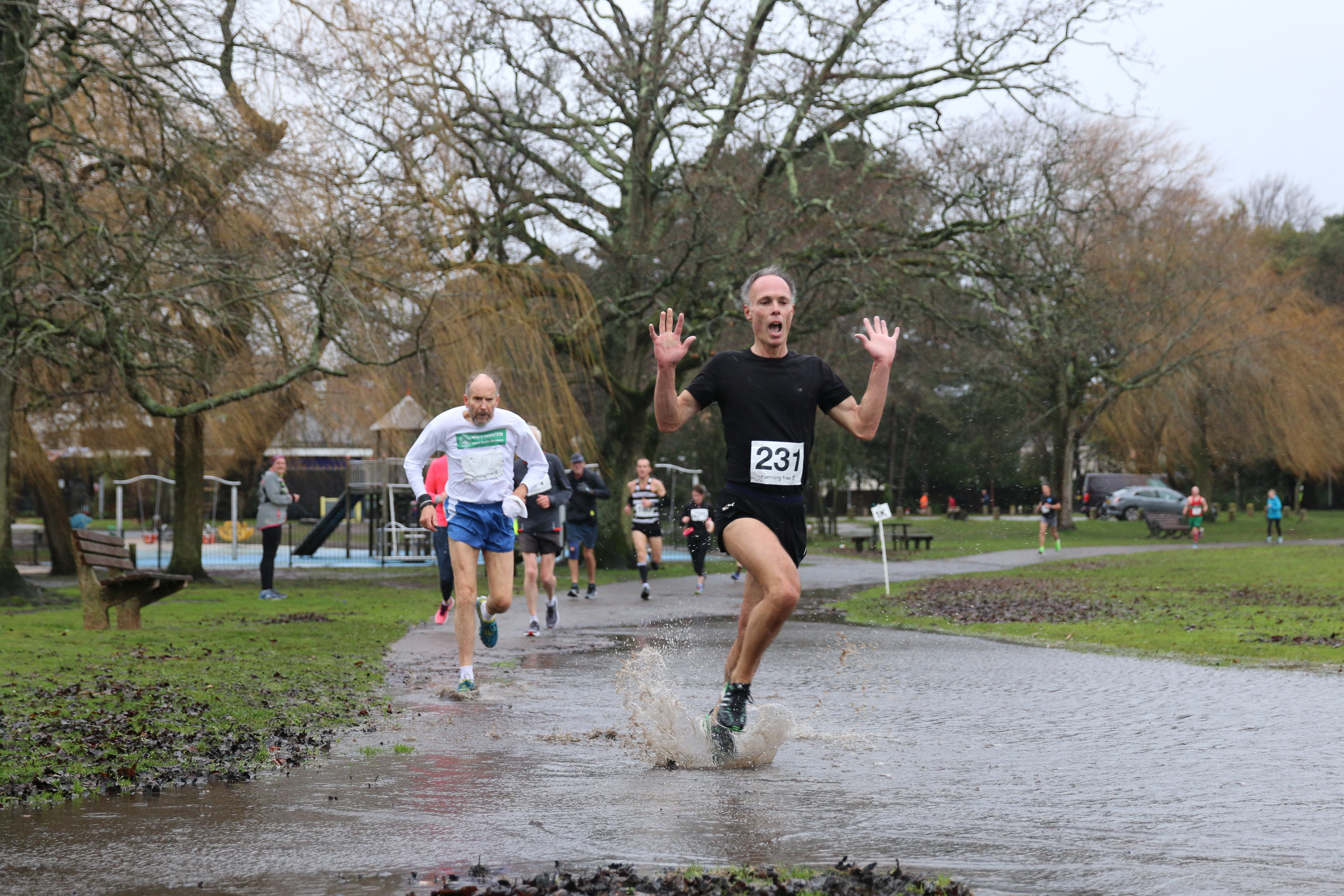 Andrew Ridley splashes through the water at Round the Lakes