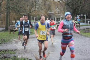 Jud Kirk splashes through the water at Round the Lakes