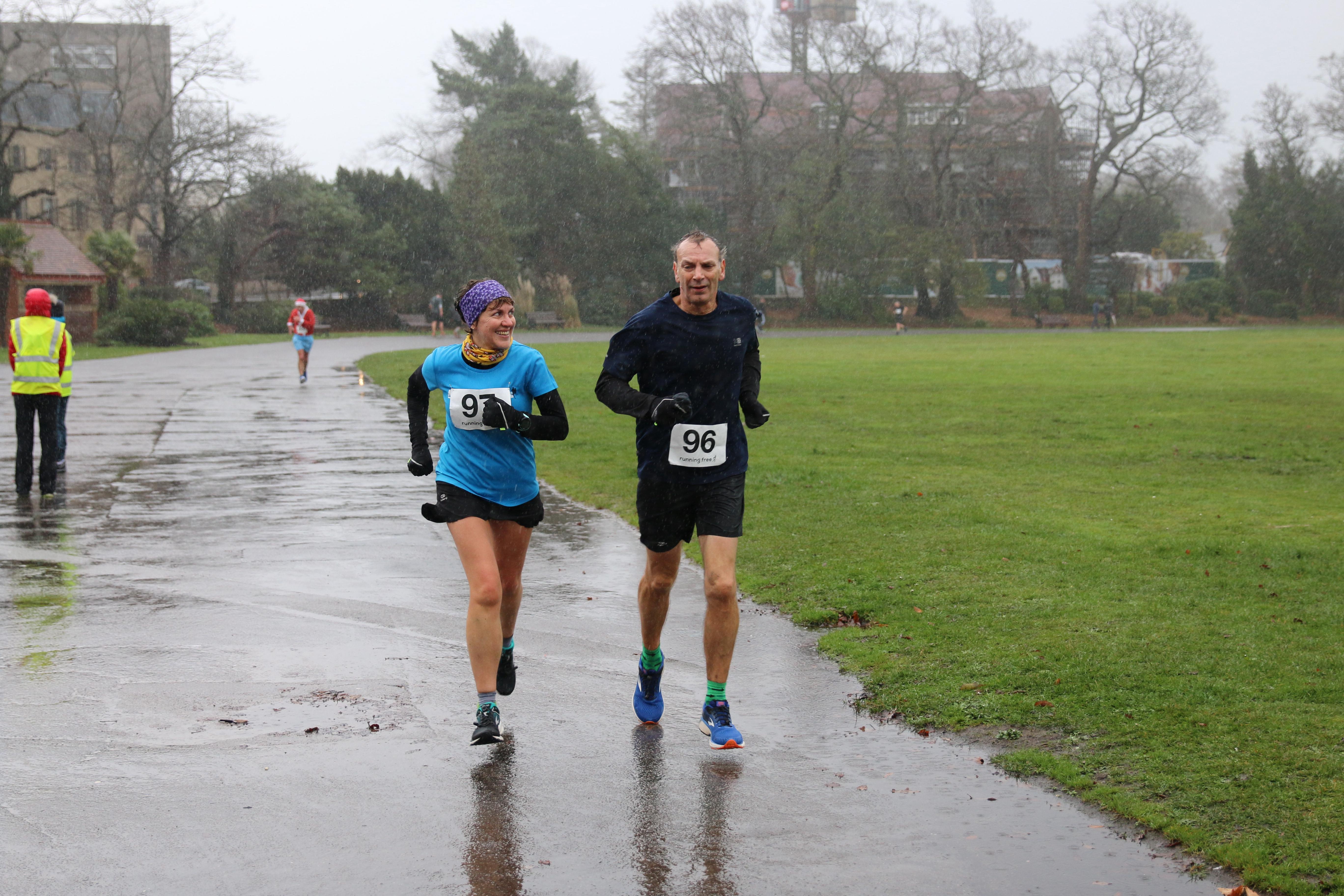 Kirsty Drewett running alongside her dad Robert