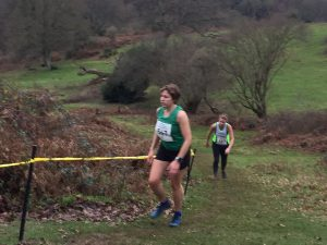 Kirsty Drewett climbs the hill in the South West Inter Counties Cross Country