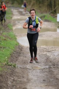 Kirsty heads along the waterlogged trails