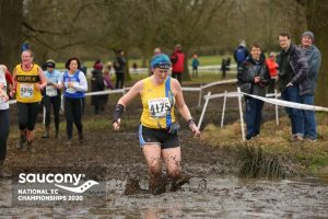 Annette Lewis goes through the mire in the National Cross Country Championships