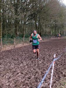Rich Brawn heads through the mud in Senior Men's race