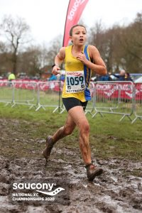 Mariah Marshall strides through the mud in the National Cross Country Championships