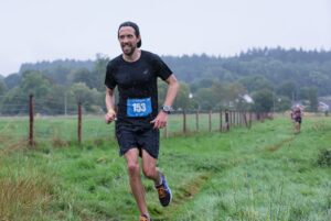 Pete Thompson goes through a field in the Dorset Ooser Marathon