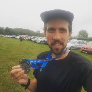 Pete shows off his medal after completing the race