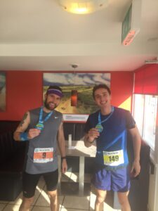 Trev and Harry show off their medals after the race