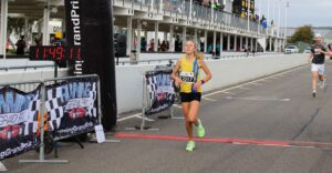 Erin crosses the line in the Running Grand Prix 5k