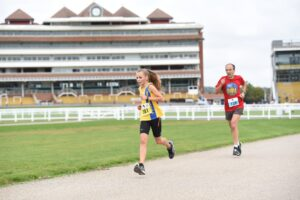 Isabel Cherrett going well in the Newbury Racecourse 5k