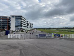 Runners come through the fence in Newbury Racecourse 5k