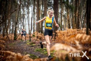 Emily Coltman in the Trail X Winter Woodland Run 4k