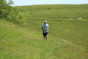 Adam Corbin makes his way across the grass