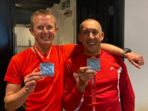 Stu and Paolo proudly display their medals