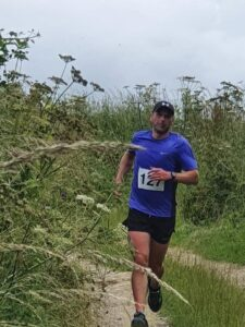Alex Goulding makes his way through the undergrowth