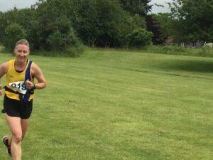 Estelle comes into the finish of the Puddletown Plod Half Marathon