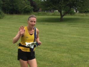 Estelle gives a wave at the Puddletown Plod Half Marathon