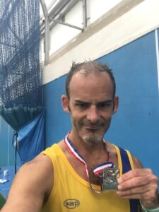 Rich Brawn with medal after Puddletown Plod Half Marathon