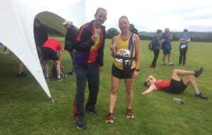 Rich and Estelle with medals at the Puddletown Plod Half Marathon