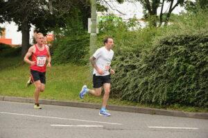 Adam Corbin racing past in the Eastleigh 10k